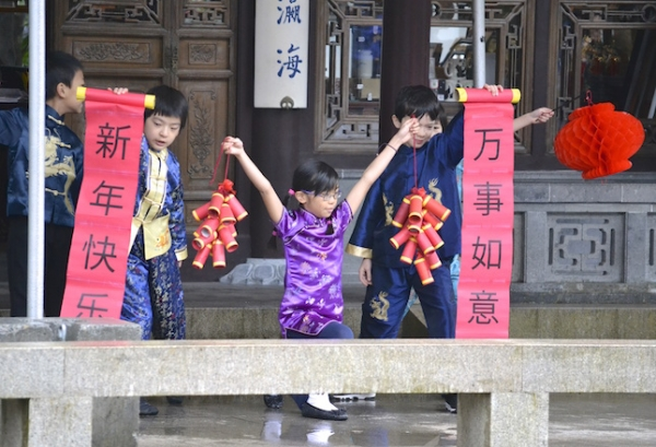 Students perform a song and dance at the Lan Su Chinese Garden. (John Payne)