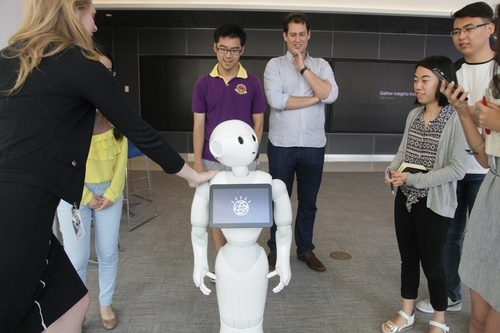 The Young Scholars admire Pepper, the robot powered by IBM Watson cognitive computing technology, in New York. (Jenny Xu)