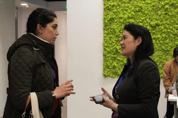 Lundberg (right) speaks to a participant after the panel discussion (Stesha Marcon).