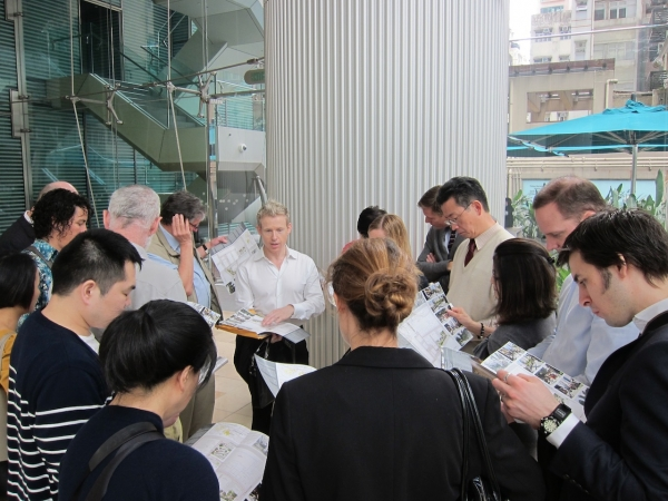 James Pierce (center), Director of the design firm Oval Partnerships, leads a tour of Old Wanchai. (Credit: Asia Society)