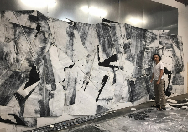 Artist in his studio with 'Tracing the Undulating Contours,' 2017, (ink, acrylic, Xuan paper).