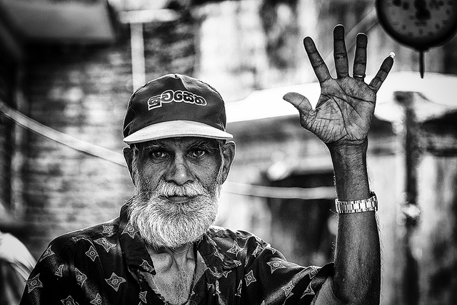 Photo of the day greetings from sri lanka asia society a man waves to the camera at the market in kandy sri lanka on september 1 2012 carbajorgioflickr m4hsunfo
