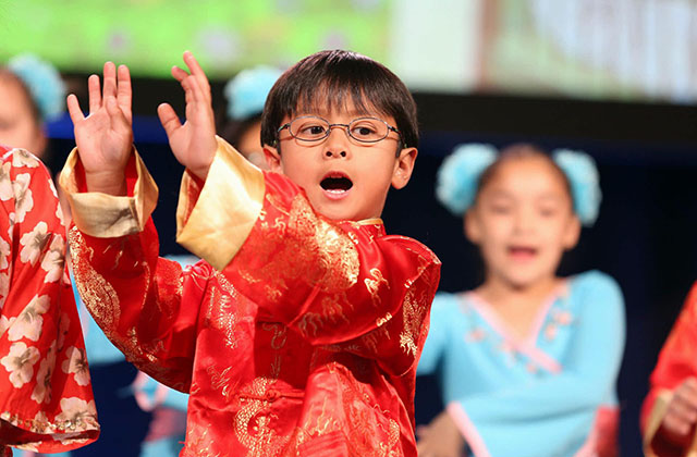 A Houston area student sings at the opening of the 2017 National Chinese Language Conference. (David Keith)