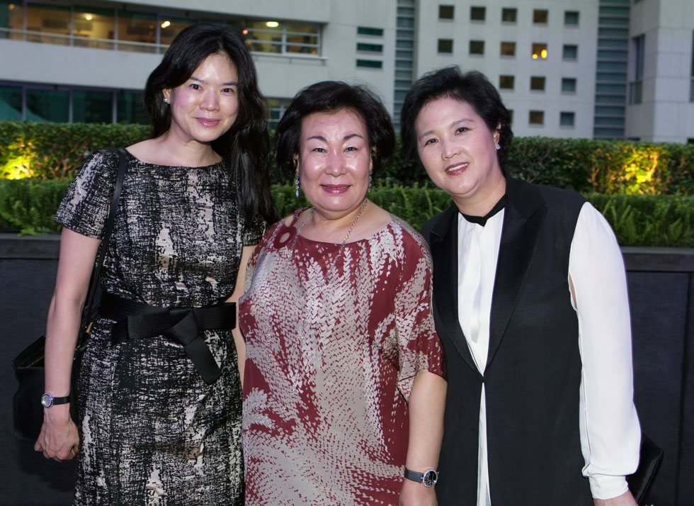 Hyun-Sook Lee (C), founder of Kukje Gallery in Seoul, flanked by guests. (Eric Powell/Asia Society)