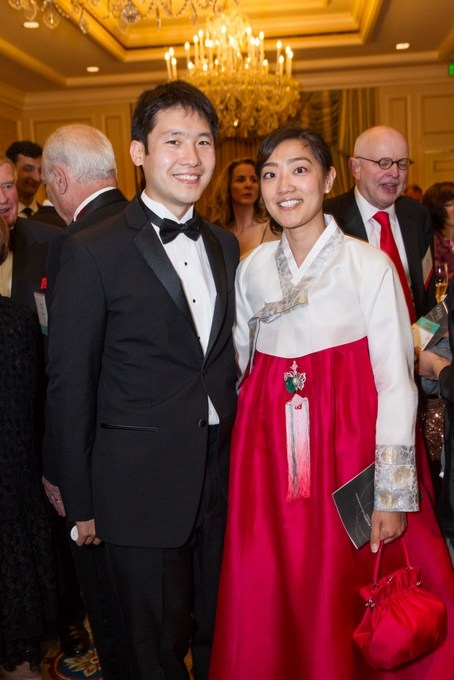 Lawrence Yang and L.J. Kwak wearing a traditional Korean cheongsam. (Drew Altizer/Asia Society)