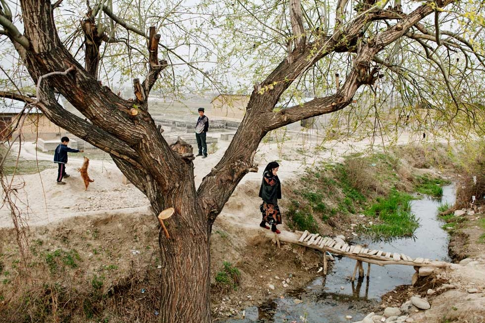 "An irrigation ditch near the Uzbekistan-Kyrgyzstan border. From ""Two Rivers."" (Carolyn Drake)"