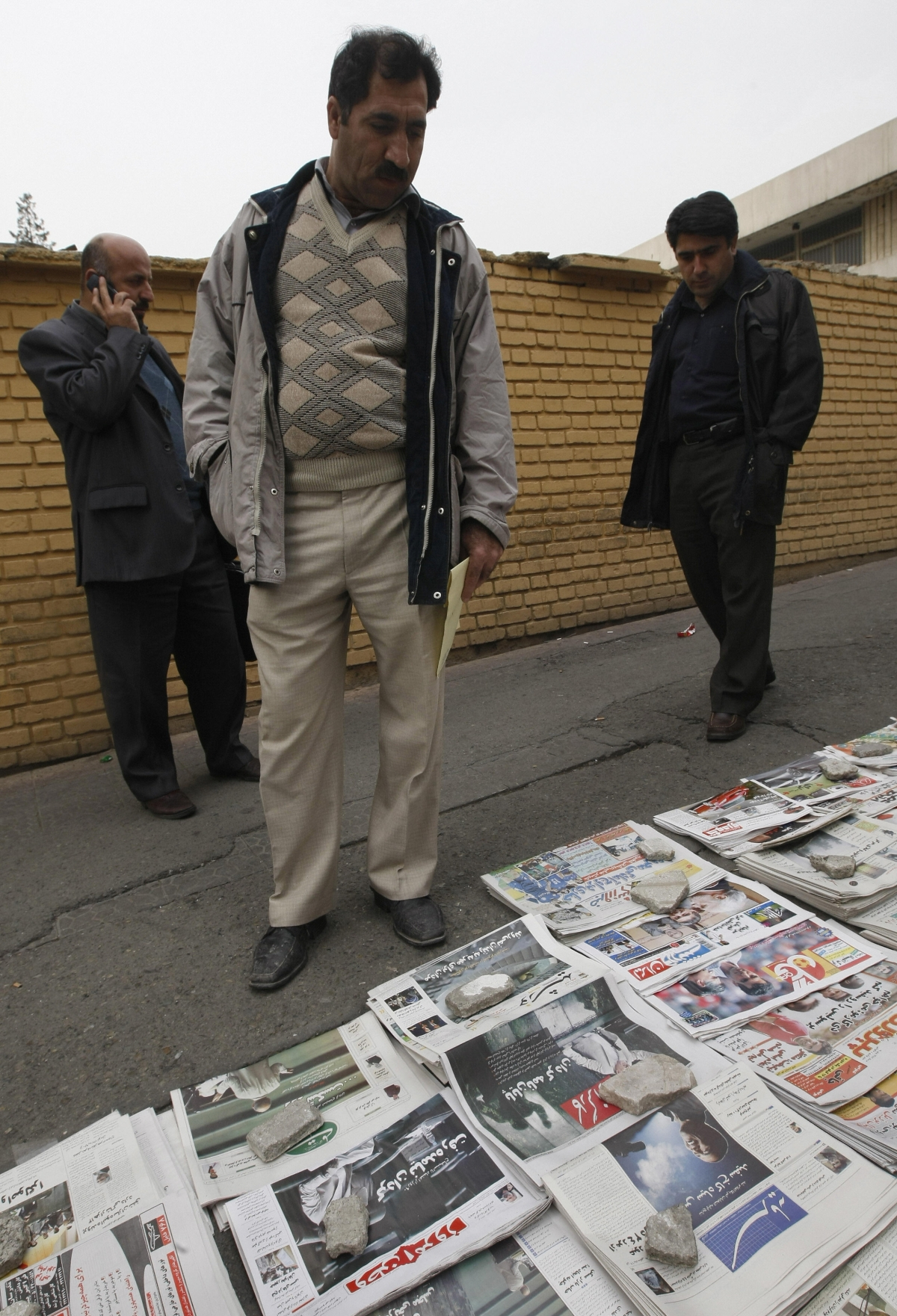 Iranian men look at newspapers bearing news and pictures of US elected president Barack Obama in Tehran on November 5, 2008. (BEHROUZ MEHRI/AFP/Getty Images)