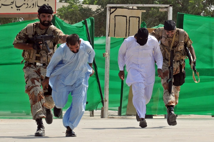 Pakistani paramilitary soldiers capture mock terrorists during an anti-terror drill in Karachi on Sept. 30, 2009. (Rizwan Tabassum/AFP/Getty Images)