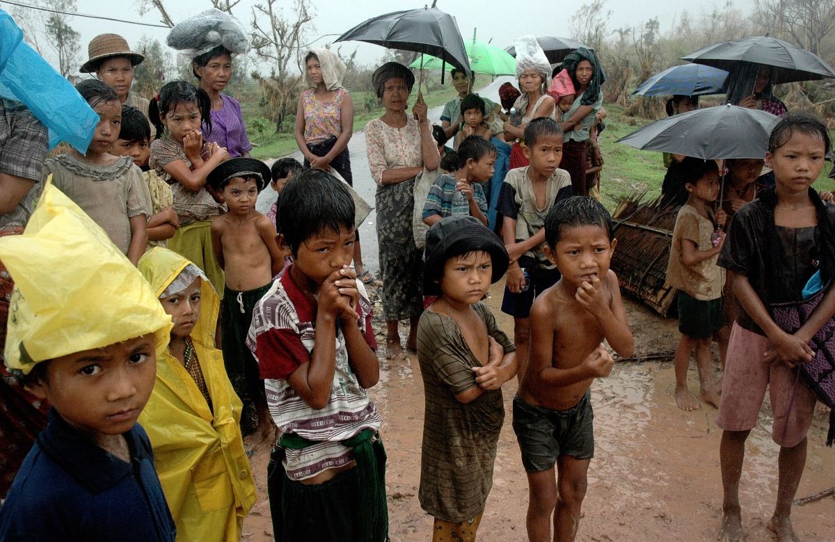 Survivors of the cyclone Nargis wait under the rain to collect relief food in Kyaiklat, in the Ayeyarwady Division of south-west Myanmar [Burma] on May 12, 2008. (Khin Maung Win/AFP/Getty Images)