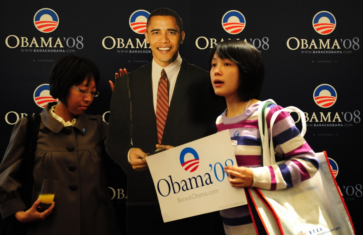 Young Chinese stand beside a lifesize cutout image of Barack Obama after he won the US presidential race at an election day event organized by the US embassy in Beijing on Nov. 5, 2008. (FREDERIC J. BROWN/AFP/Getty Images)