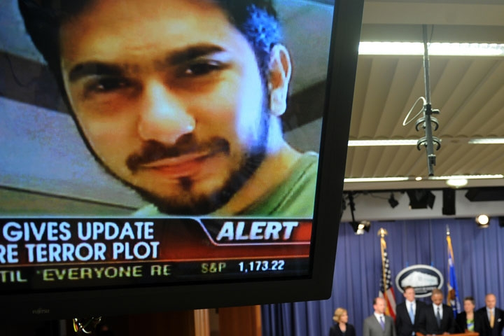 An image of terror suspect Faisal Shahzad is seen on a TV screen as federal and New York City officials hold a briefing on the Times Square attempted bombing, in Washington, DC, on May 4, 2010. (Jewel Samad/AFP/Getty Images)