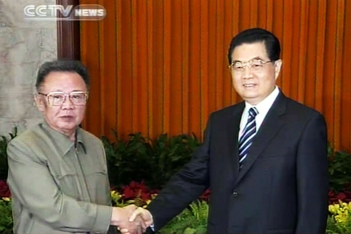 A TV grab from CCTV taken on May 7, 2010 shows Chinese President Hu Jintao (R) shaking hands with North Korean leader Kim Jong-Il in Beijing on May 7. (STR/AFP/Getty Images)