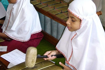 Indonesian children playing gamelan after school. (Yayah Khisbiyah)