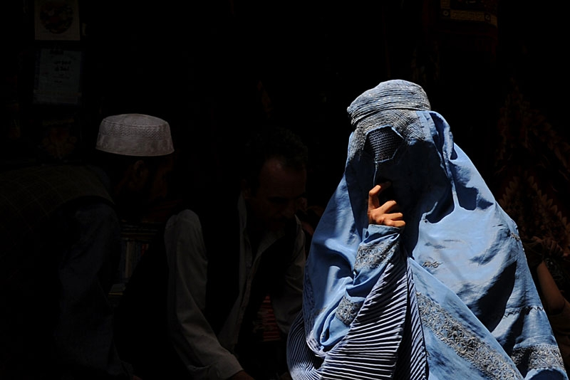 A burqa-clad Afghan woman walks on a street in Kabul on August 10, 2010. (Shah Marai/AFP/Getty Images)