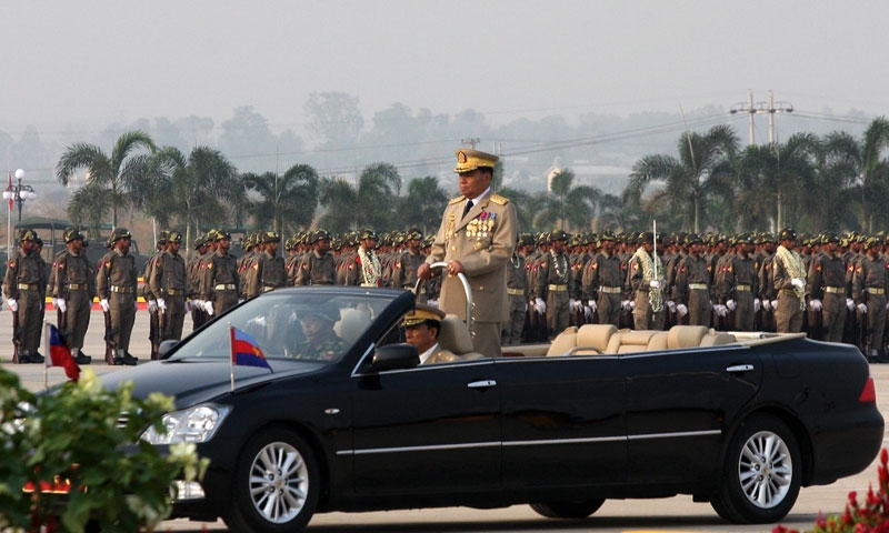 Myanmar's junta chief Than Shwe reviews an honor guard from his car on Armed Forces Day in the administrative capital of Naypyidaw on March 27, 2009. (Hla Hla Htay/AFP/Getty Images)