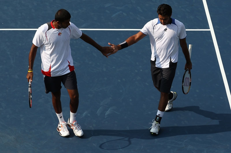 Aisam-ul-haq Qureshi (R) of Pakistan shakes hands with teammate Rohan Bopanna of India after defeating Bob Bryan and teammate Mike Bryan of the USA 7-6(8),7-5 during their quarterfinal match on day 5 of the Legg Mason Tennis Classic on August 6, 2010 in Washington, DC. (Streeter Lecka/Getty Images)