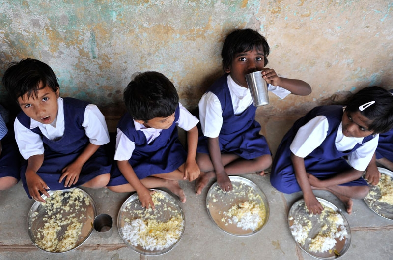 Indian schoolchildren eat food served as part of The 'Midday Meal' scheme at a Government Primary School in Hyderabad on June 23, 2010. (Noah Seelam/AFP/Getty Images)