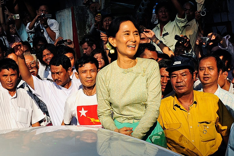 Myanmar's newly-released opposition leader Aung San Suu Kyi (C) smiles as she arrives at the National League for Democracy (NLD) headquarters in Yangon on November 15, 2010. (STR/AFP/Getty Images)