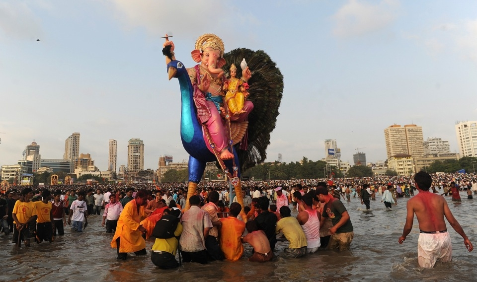 Mumbaikers immerse an idol of Ganesh into the Arabian Sea on September 22, 2010. (Punit Paranjpe/AFP/Getty Images)