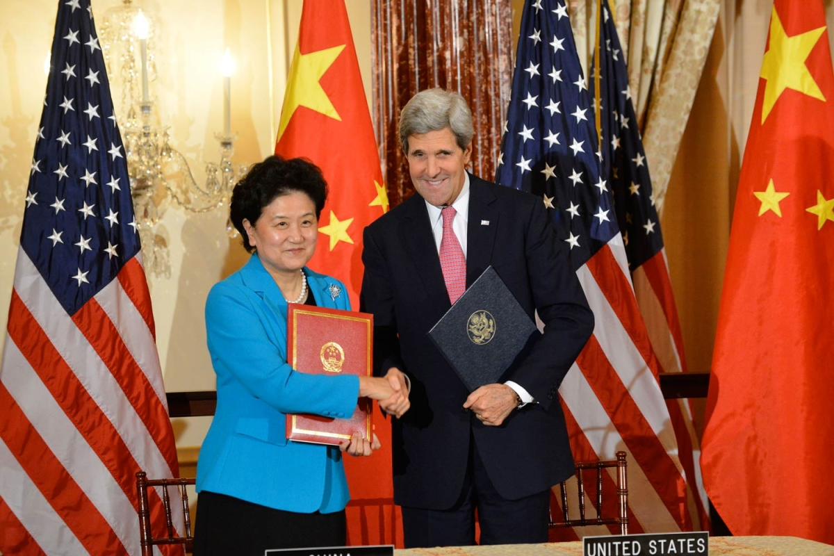 Madam Liu (left) with U.S. Secretary of State John Kerry (right). (Photo: U.S. Department of State/flickr)