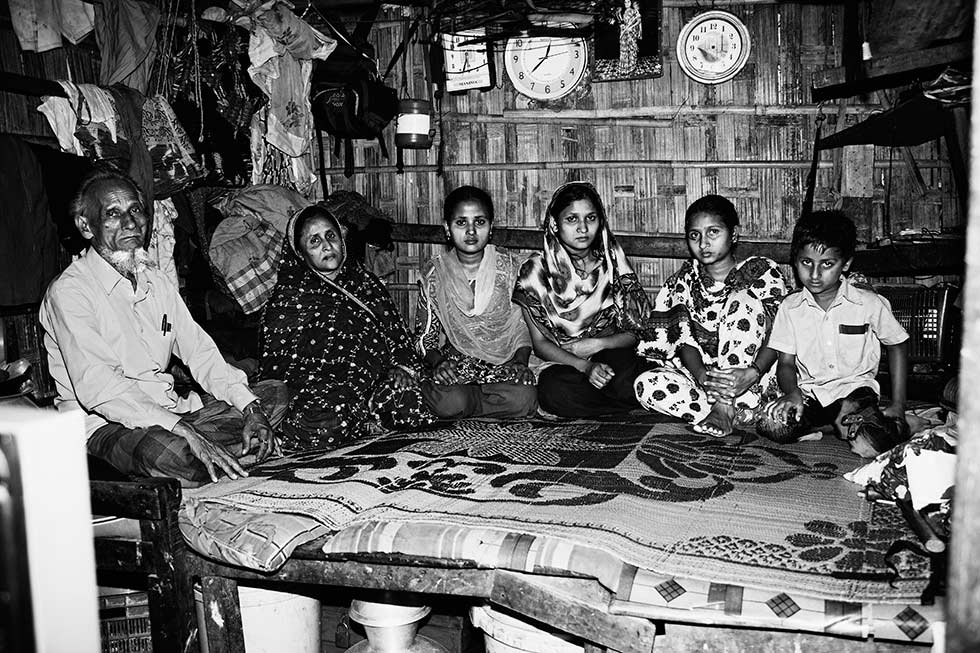 A family of six, who had been living in the same bamboo structure for 21 years, in Chittagong, Bangladesh. The mother and three sisters are all employed at Ready Made Garments' factories. (Gazi Nafis Ahmed)