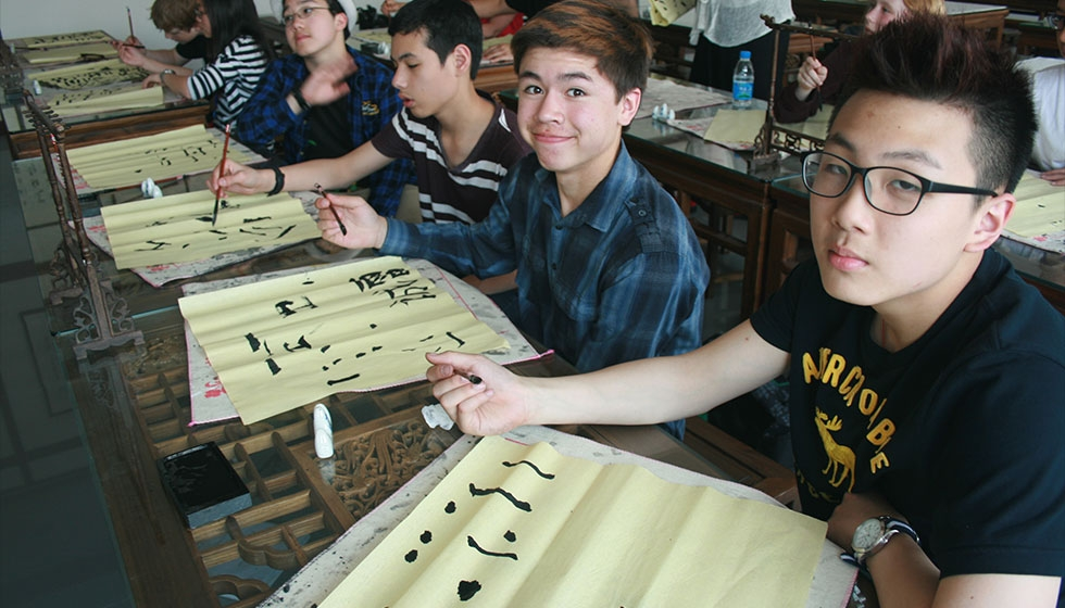 8th grade China Research Residency: calligraphy class at their sister school (Portland Public Schools)