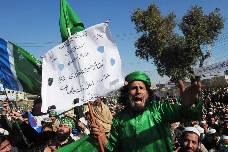 Activists of the Pakistani fundamentalist Islamic party Jamaat-i-Islami shout slogans calling for an en end to American drone attacks in tribal areas on January 23, 2011 during an anti-US protest rally in Peshawar. (A Majeed /AFP/Getty Images)