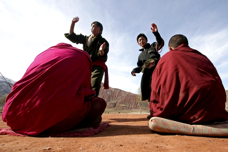 Students take part in a debate about Buddhism doctrine outdoors at the Jigmei Gyaltsen School on October 25, 2005 in Maqin County of Guoluo Prefecture, Qinghai Province, northwest China. (China Photos /Getty Images)