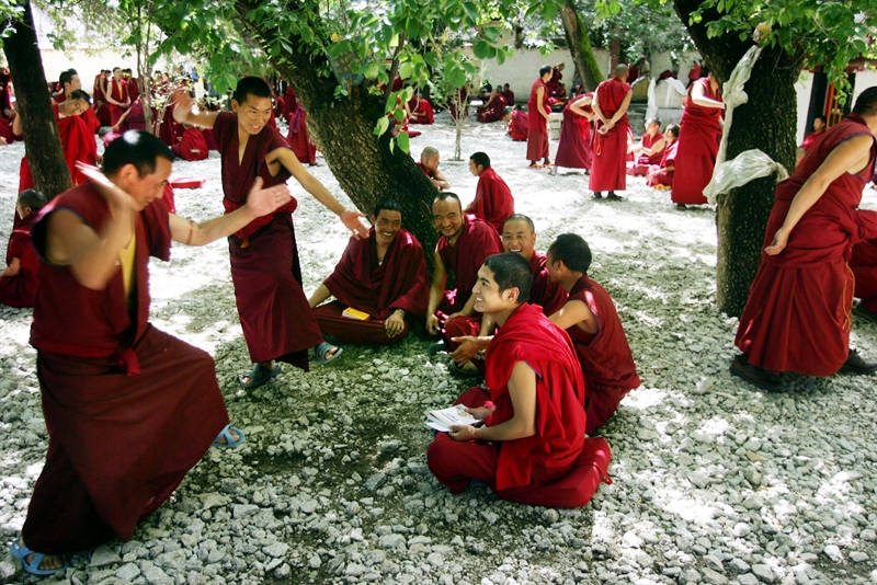Monks take part in a daily debate at the Sera Monastery on July 4, 2006 in Lhasa, Tibetan Autonomous Region, China. (China Photos /Getty Images)