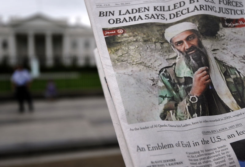 A man takes pictures of the front page of a newspaper featuring a picture of Al-Qaeda leader Osama bin Laden, in front of the White House in Washington, DC, on May 2, 2011. (Jewel Samad/AFP/Getty Images)