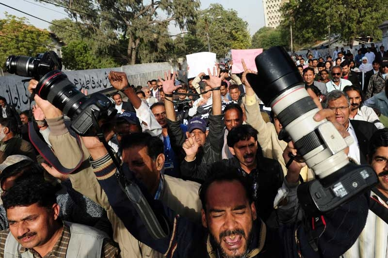 Pakistani journalists protest the killing of Wali Khan Babar, a reporter with local television channel Geo News, during a rally in Karachi on Jan. 14, 2011. Babar was believed to be yet another victim of ongoing targeted killings on Jan. 13 in Karachi. (Asif Hassan/AFP/Getty Images)