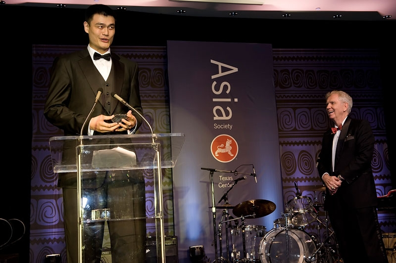 Yao Ming receives an award from Charles C. Foster, Chairman of the Asia Society Texas Center, at the Texas Center's annual Tiger Ball in Houston in 2010. (Jeff Fantich Photography)