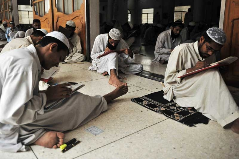 Pakistani and foreign religious students taking an exam at the Jamia Binoria madrasa in Karachi in 2009. (Rizwan Tabassum/AFP/Getty Images)