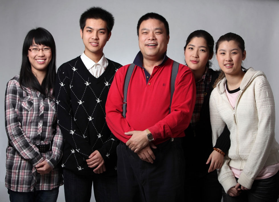 "Xiao Baiyou, China's ""Wolf Dad,"" surrounded by his four children."