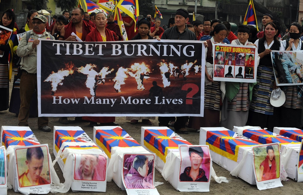 Tibetans offer prayers near mock coffins to represent the victims self-immolation during a rally in Siliguri, in the Indian state of West Bengal, on February 8, 2012. China said February 7 it would 'resolutely crack down' on any attempts to instigate violence in Tibetan-inhabited areas, where authorities have launched a deadly clampdown on protesters. (Diptendu Dutta/AFP/Getty Images)