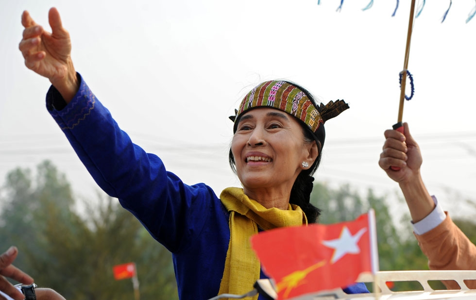 Myanmar democracy campaigner Aung San Suu Kyi greets her supporters wearing a traditional costume as she leaves after her speech in Lashio, the northern Shan state, on March 17, 2012. (Soe Than Win/AFP/Getty Images)