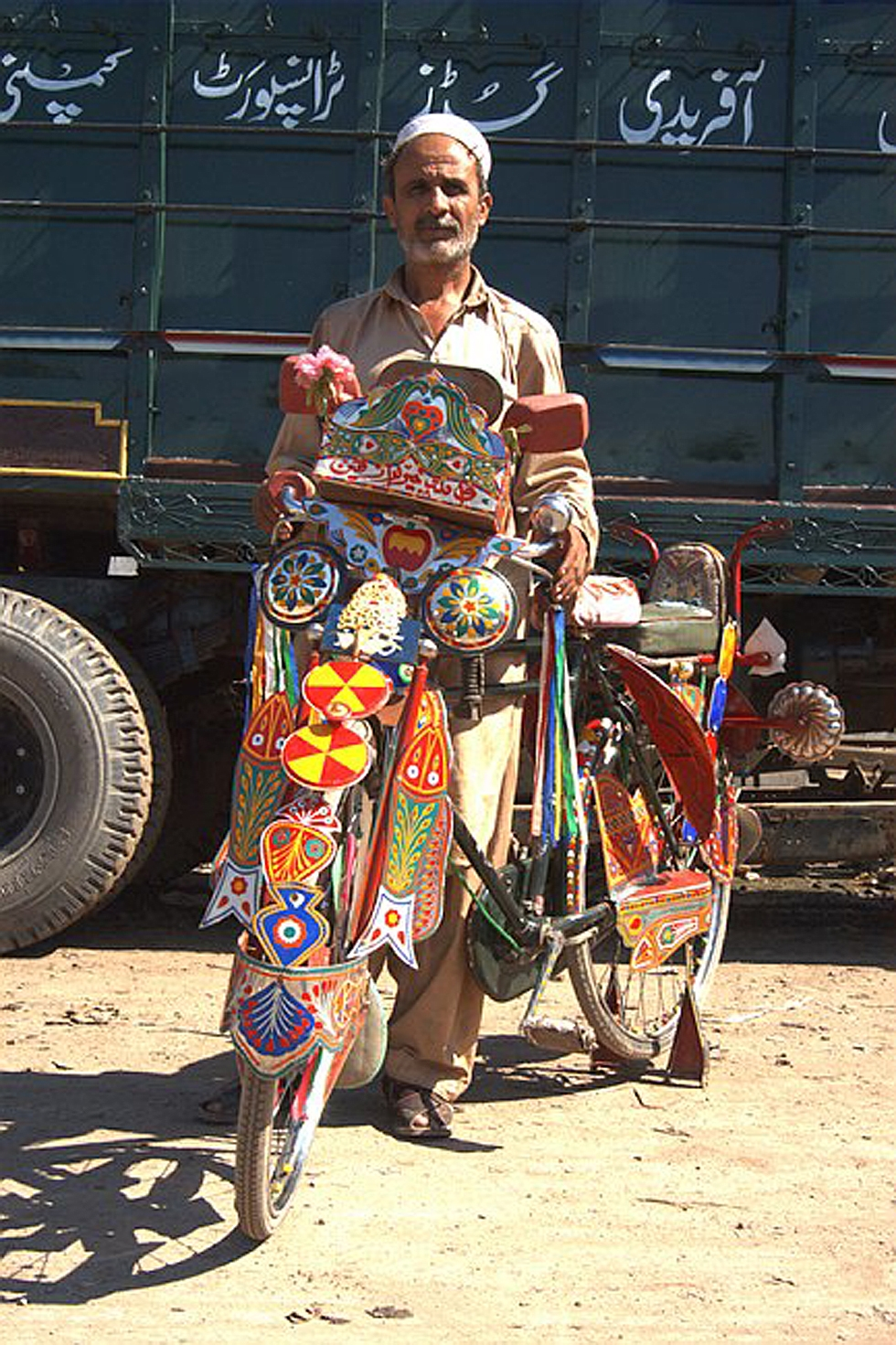 Other forms of public and private transportation in Pakistan such as buses, rickshaws and bicycles also get decorated in the same elaborate manner. (Peter Grant)