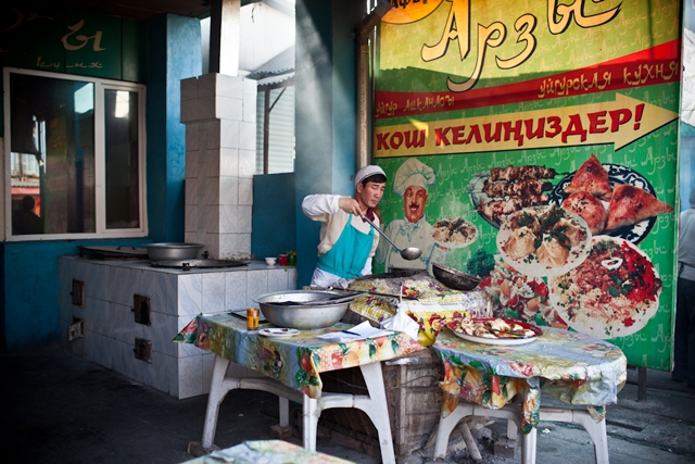 A Kyrgyz cook is preparing a range of local cuisine in anticipation of the lunch-hour crowd in a bazaar in Bishkek. (Sue Anne Tay)