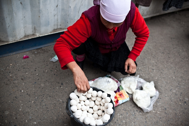 A female vendor arranges local candy in Osh Bazaar. (Sue Anne Tay)