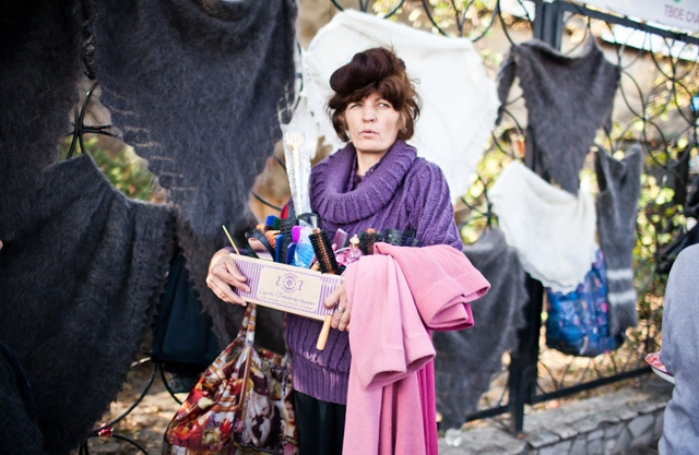 An ethnic Russian woman trader parades her cart of toiletries and cosmetics. (Sue Anne Tay)