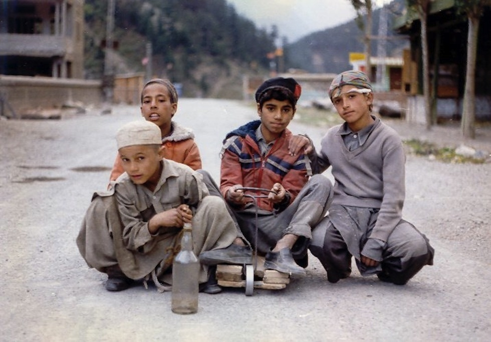 Boys play with their soapbox car in Kohistan. (Jim/Flickr)