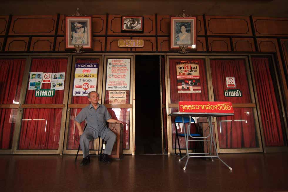 This ticket taker has been doing his job for more than 20 years at the Nakon Non Rama Theater in Nonthaburi, Thailand. (Philip Jablon)
