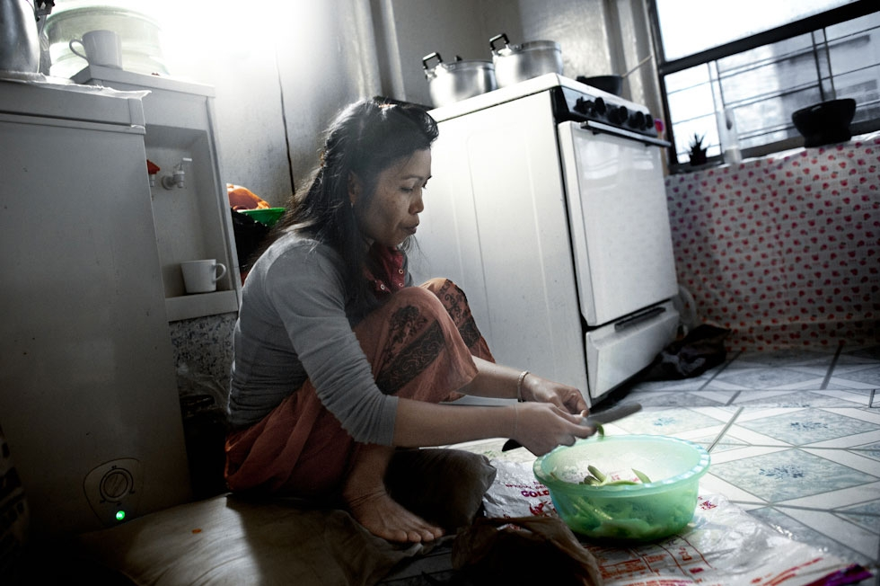 Thon Khoun, 47, cooks in the kitchen of her Bronx apartment. Mrs. Khoun immigrated as a refugee in 1985 and is a single mother of four. (Pete Pin)