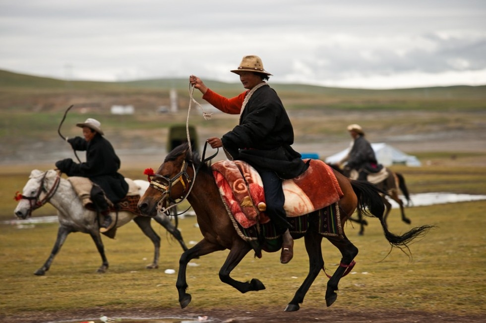 Nomad cowboys from far and wide gallop to the edge of the fairgrounds. (Michael Yamashita)
