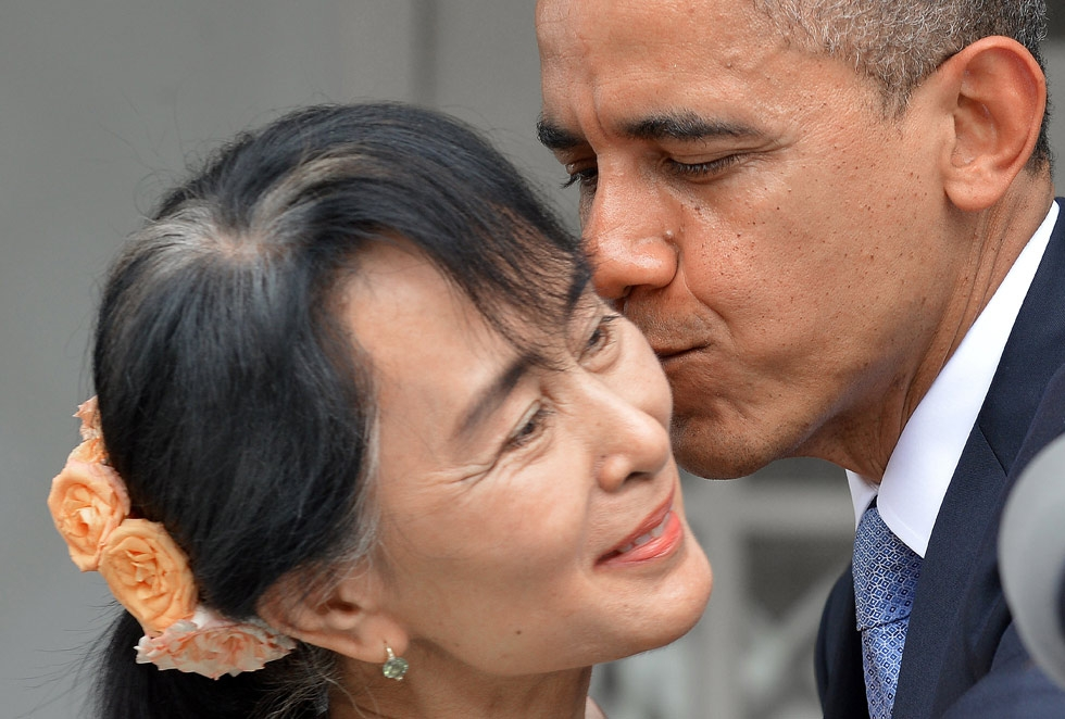 U.S. President Barack Obama kisses Myanmar opposition leader Aung San Suu Kyi after making a speech at her residence in Yangon on Nov. 19, 2012. (Jewel Samad/AFP/Getty Images)