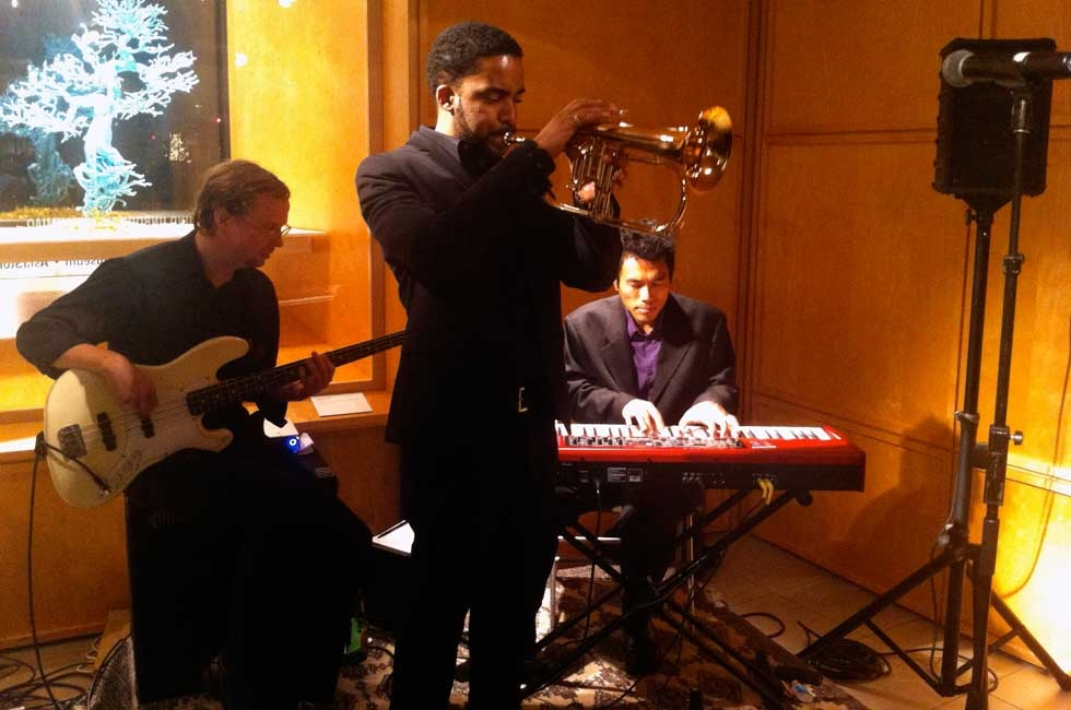L to R: A jazz trio comprised of Jon Price (bass), Jean Caze (trumpet), and A J Khaw (piano) kept a steady groove going during the party. (Asia Society)