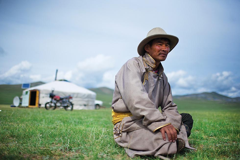 Myagmarchuluun, a herder in northern Mongolia, takes a break near his friend's ger (yurt). (Taylor Weidman)