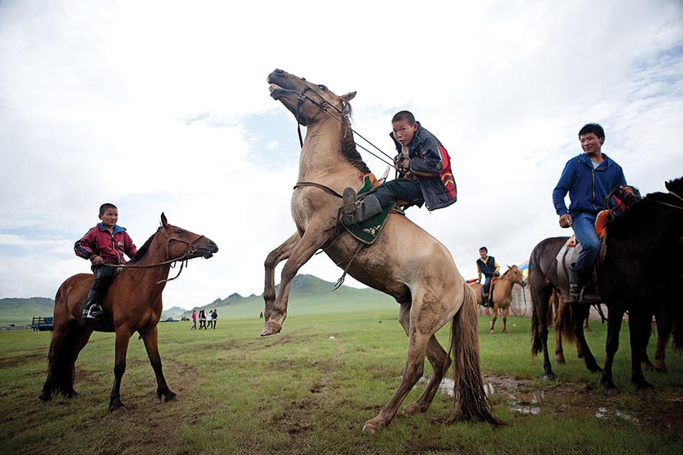Naadam brings out the holiday spirit and competitiveness in everyone, both young and old. This young man shows off his horsemanship in front of his friends. (Taylor Weidman)