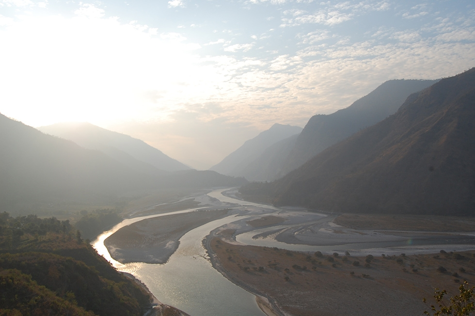 A view of the Tamur River in eastern Nepal, a lifeline for hundreds of thousands of farmers and more than 800 species of birds, as seen from Kurule Tenupa. The Tamur has declined in volume by more than 30 percent in the last five years primarily due to adverse impacts of climate change. (Rajeev Goyal)