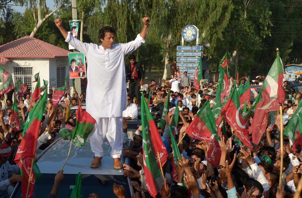 Pakistani cricketer turned politician Imran Khan led Western activists and thousands of supporters on a defiant march to the tribal belt to protest against U.S. drone strikes in Mianwali, Pakistan, on October 6, 2012. (A Majeed/AFP/GettyImages)